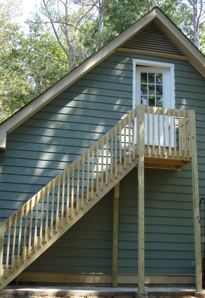 Exterior stairs making previously wasted space over garage completely useful.