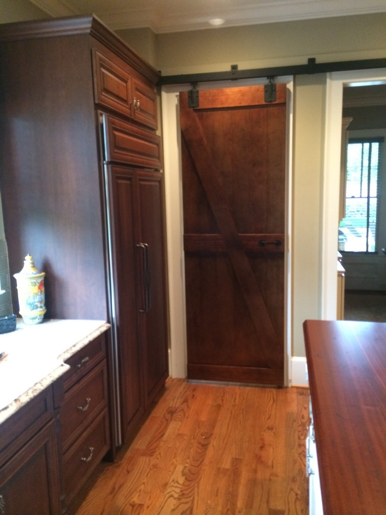 Here is a closer look at the decorative barn door built to separate the kitchen from the connected utility area (a laundry/pantry/office area). It is a full 8 ft. high.