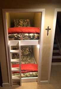 The Basement Bunk Bed makes fun, efficient, and cosy use of the often wasted wedge-shaped area underneath the stairs. There is also lighting for each bed for reading or late-night storytelling.